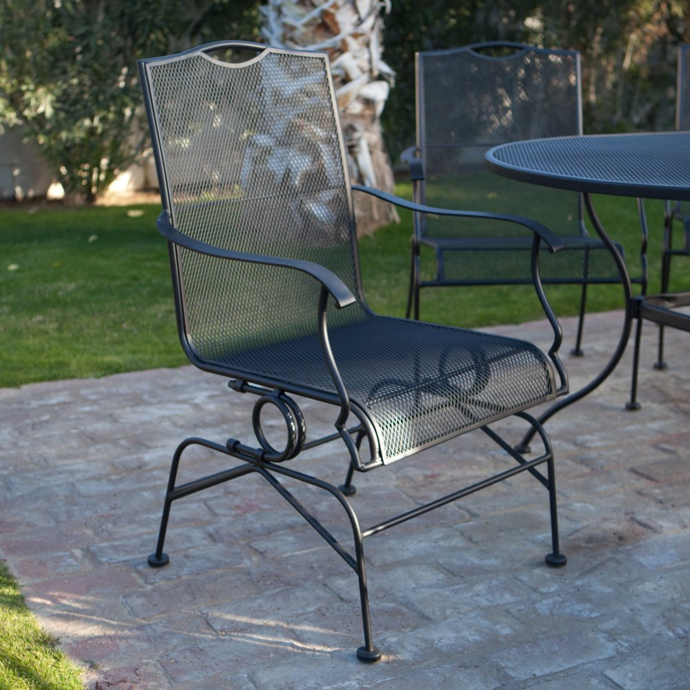 This Woodard wrought iron coil spring dining chair set not only looks ...