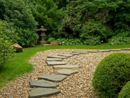 This stepping stone path in a Zen garden is highlighted by the surrounding  stonesA Simple Stepping Stone Path  An Easy DIY Project   The Garden And  . Garden Paths And Stepping Stones. Home Design Ideas