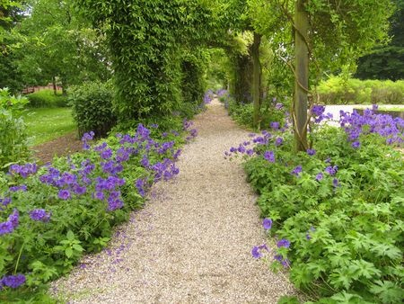 The Texture Of A Gravel Garden Pathway Makes It Very Appealing
