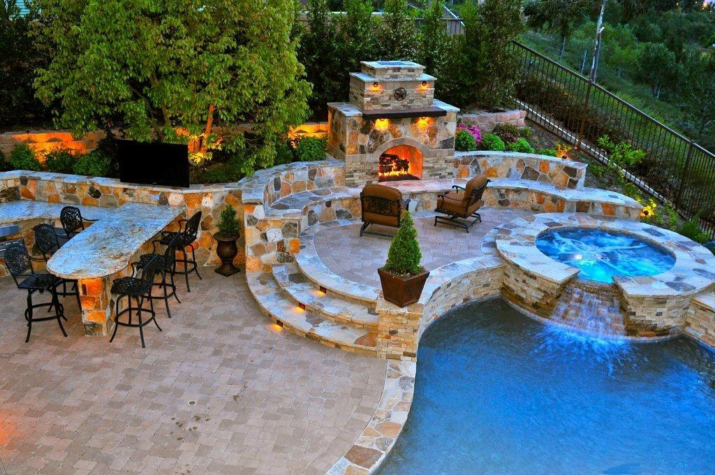Inspiration dreamy patios and backyards the garden and for Pool with fireplace