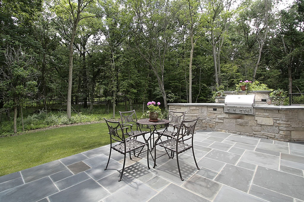 What s right for your garden a stone patio or decking for Whats a terrace